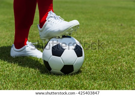 Soccer, football, player with ball - stock photo