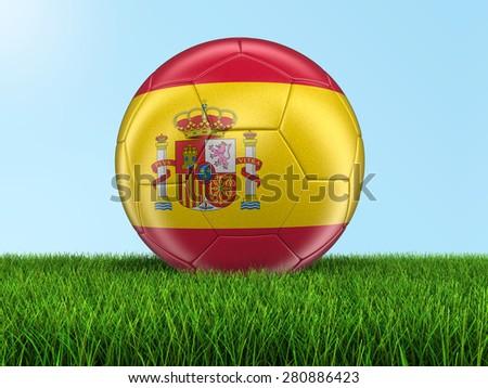 Soccer football with Spanish flag on grass - stock photo