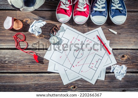 Soccer formation tactics on school desk - stock photo