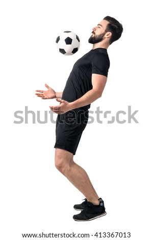 Soccer futsal player stopping the ball with his chest. Full body length portrait isolated over white background.  - stock photo