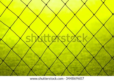 Soccer goal net on yellow to green background - stock photo