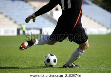 Soccer goalkeeper makes a free kick - stock photo