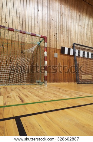 Soccer goalpost in old gym hall - stock photo