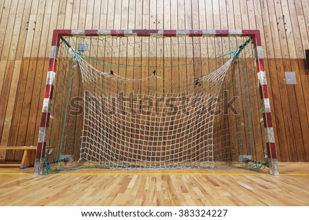 Soccer goalpost in old gymhall - stock photo