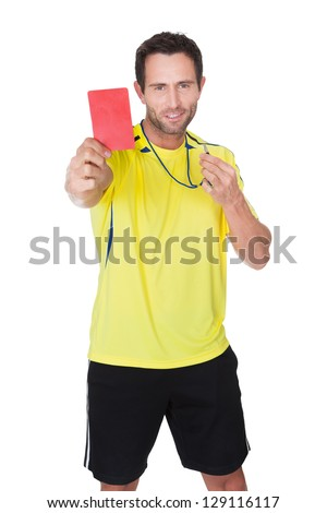 Soccer judge whistling and showing yellow card. Isolated on white - stock photo