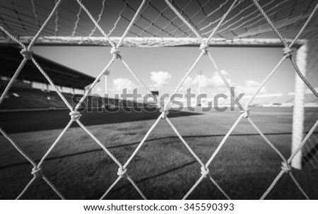 soccer net  at soccer stadium ,  black and white - stock photo