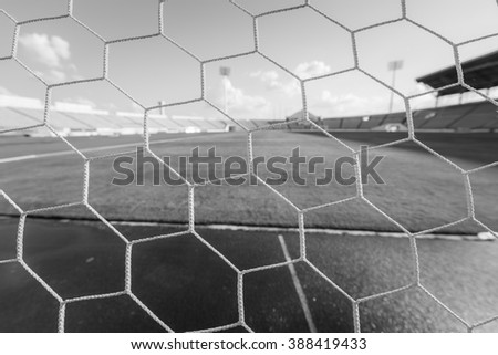 soccer net  at soccer stadium , black and white. - stock photo