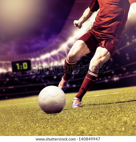 soccer or football player running on the field - stock photo