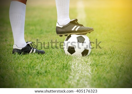 soccer or football player standing with ball on the field for Kick the soccer ball - stock photo