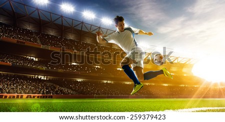 Soccer player in action on night stadium background panorama - stock photo