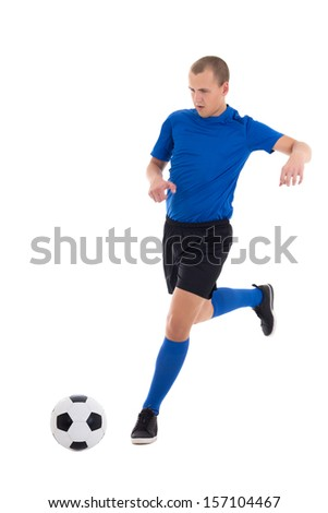 soccer player in blue kicking leather ball isolated on white background - stock photo