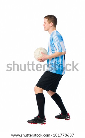 Soccer player is ready to throwing a ball, white background. - stock photo