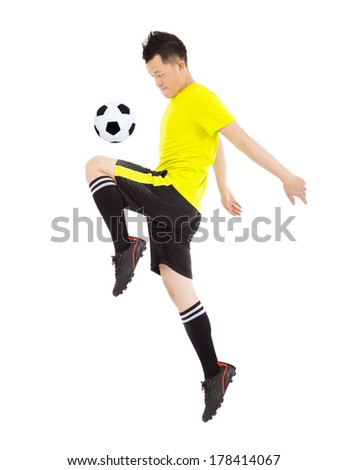 soccer player jumping to stop the ball - stock photo