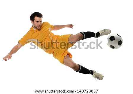 Soccer player kicking ball isolated over white background - stock photo