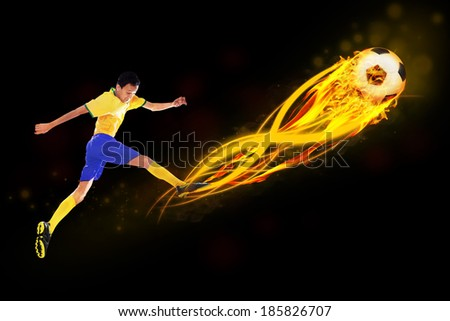 Soccer player kicking the ball with flame from the ball - stock photo