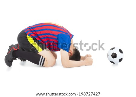 soccer player lose the game and kneel down - stock photo