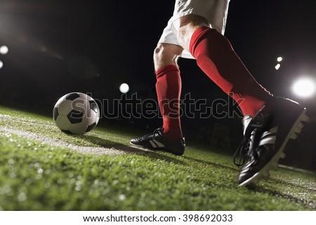 Soccer player making a corner kick - stock photo