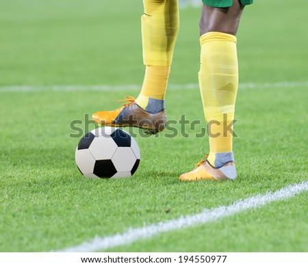 Soccer player's leg on ball - stock photo