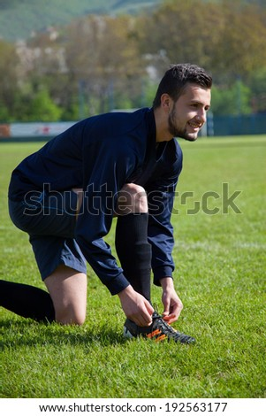 soccer player shooting at goal - stock photo