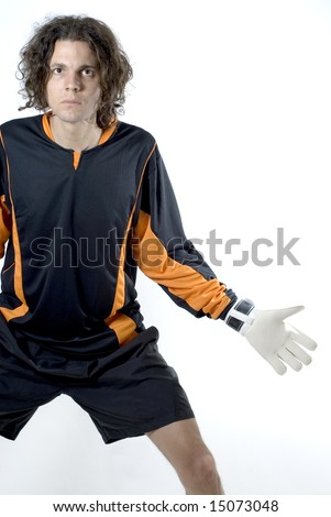 Soccer player wearing goalie gloves stands ready to catch the ball. Vertically framed photograph - stock photo