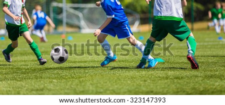 soccer players running with ball - stock photo