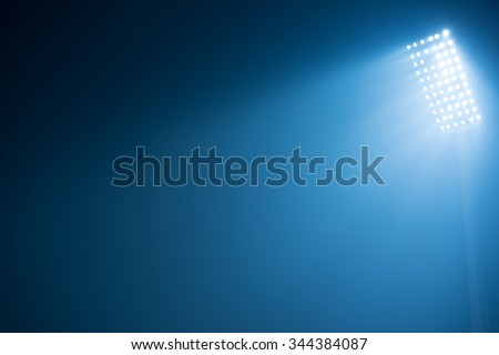 soccer stadium lights reflectors against black background - stock photo