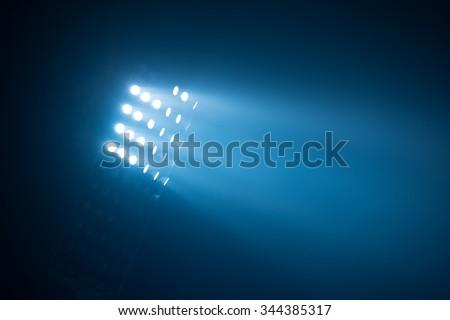 soccer stadium lights reflectors against black background - stock photo
