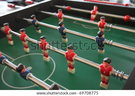 Soccer table game with red and blue players - stock photo