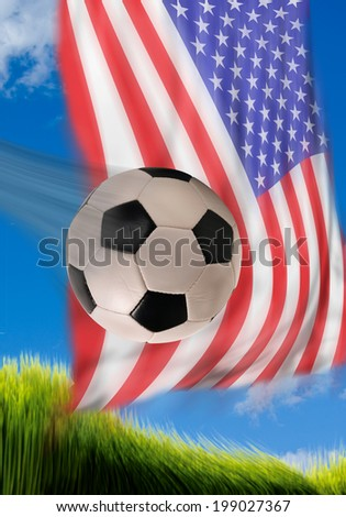 Soccerball flying fast with American flag in background. - stock photo