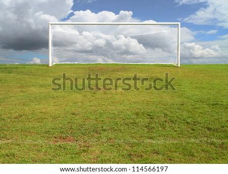 soccerball goal on blue sky - stock photo