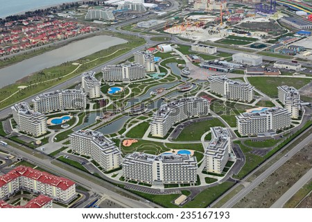 SOCHI, ADLER, RUSSIA - MAR 02, 2014: Azimut Hotel Sochi 3 and Sochi amusement Park near Olympic Park in Adlersky District, Krasnodar Krai, top view - stock photo