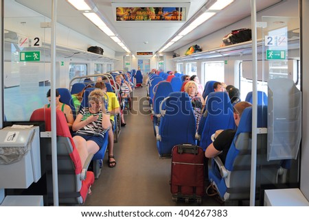 "SOCHI, RUSSIA - AUG 03, 2015: The Russian Railways. Passengers in high speed electric express train ""Lastochka"", Krasnodar Krai - stock photo"