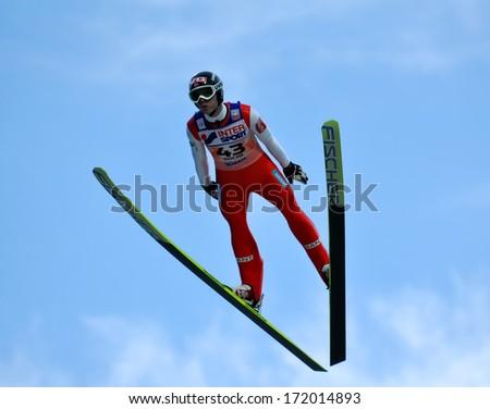 "SOCHI, RUSSIA - DECEMBER 9, 2012: FIS Ski Jumping World Cup in Sochi on tramplin complex ""RusSki Gorki"". Unidentified athlete in flight. - stock photo"