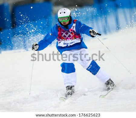 SOCHI, RUSSIA - FEB 10, 2014: Benjamin CAVET (FRA) at Men's Moguls Final of Freestyle skiing at Sochi 2014 XXII Olympic Winter Games - stock photo