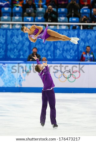 Sochi, RUSSIA - February 11, 2014: Andrea DAVIDOVICH and Evgeni KRASNOPOLSKI (ISR) on ice during figure skating competition of pairs in short program at Sochi 2014 XXII Olympic Winter Games - stock photo