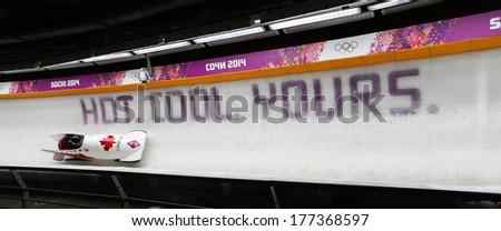 Sochi, RUSSIA - February 16, 2014: Canada 1 team at two-man bobsleigh heat at Sochi 2014 XXII Olympic Winter Games - stock photo