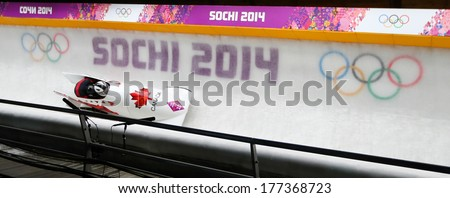 Sochi, RUSSIA - February 16, 2014: Canada 2 team at two-man bobsleigh heat at Sochi 2014 XXII Olympic Winter Games - stock photo