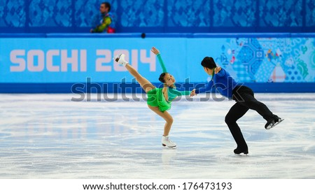 Sochi, RUSSIA - February 11, 2014: Cheng PENG and Hao ZHANG (CHN) on ice during figure skating competition of pairs in short program at Sochi 2014 XXII Olympic Winter Games - stock photo