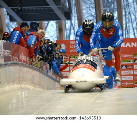 """SOCHI, RUSSIA - FEBRUARY 16: FIBT Viessmann Bobsleigh and Skeleton World Cup on February 16, 2013 in Sochi, Russia. Center Luge """"Sanki"""". Team Russia on track. - stock photo"""