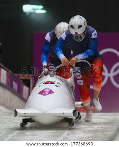 Sochi, RUSSIA - February 16, 2014: Korea 1 team at two-man bobsleigh heat at Sochi 2014 XXII Olympic Winter Games - stock photo