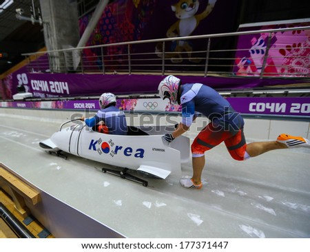 Sochi, RUSSIA - February 16, 2014: Korea 2 team at two-man bobsleigh heat at Sochi 2014 XXII Olympic Winter Games - stock photo