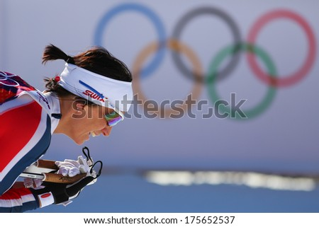 Sochi, RUSSIA -?? February 8, 2014: Marit BJOERGEN wins  in ladies' Skiathlon 7.5 km Classic + 7.5 km Free of Sochi 2014 XXII Olympic Winter Games - stock photo