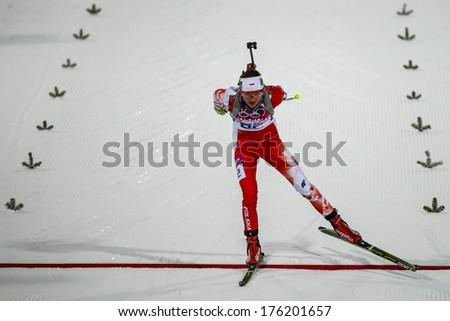 Sochi, RUSSIA - February 9, 2014: Monika HOJNISZ (POL) at Biathlon Women's 7.5 km Sprint at Sochi 2014 XXII Olympic Winter Games - stock photo