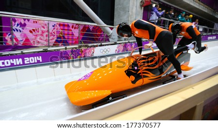Sochi, RUSSIA - February 16, 2014: Netherlands 1 team at two-man bobsleigh heat at Sochi 2014 XXII Olympic Winter Games - stock photo