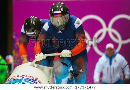 Sochi, RUSSIA - February 16, 2014: Russian Fed. 1 team at two-man bobsleigh heat at Sochi 2014 XXII Olympic Winter Games - stock photo