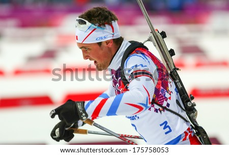Sochi, RUSSIA - February 9, 2014: Simon DESTHIEUX (FRA) during Biathlon Men's Sprint 10 km competition at Sochi 2014 XXII Olympic Winter Games - stock photo