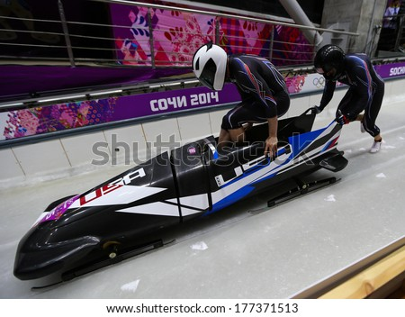 Sochi, RUSSIA - February 16, 2014: United States 2 team at two-man bobsleigh heat at Sochi 2014 XXII Olympic Winter Games - stock photo