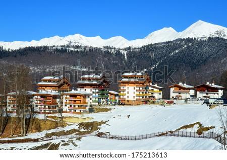 SOCHI, RUSSIA - FEBRUARY 4, 2014: Winter Olympic Games in 2014, mountain Olympic village in Krasnaya Polyana, Sochi city - stock photo