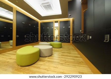 SOCHI, RUSSIA - JUL 27, 2014: The interior of the locker room with black cupboards, mirror and seats in Health spa center in the Hotel Radisson Blu Paradise Resort and Spa - stock photo