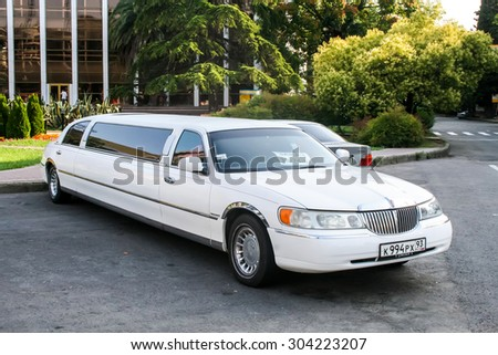 SOCHI, RUSSIA - JULY 19, 2009: White limousine Lincoln Town Car at the city street. - stock photo
